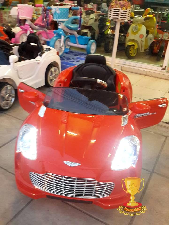 รถแบตเตอรี่เด็กนั่ง รุ่น 3168 ยี่ห้อแอสตั้นมาติน สีแดง