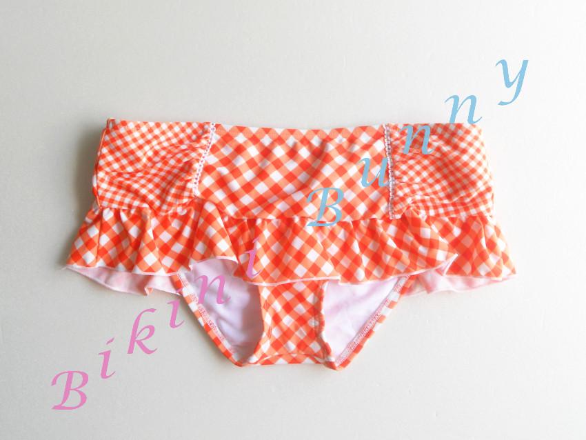 รหัส b8 (Size S, M) กางเกงว่ายน้ำลายกราฟฟิกสีขาวส้ม แต่งระบาย --> Ariazona